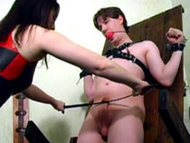 Hot Domme torturing male sub